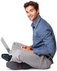 guy sitting with a laptop