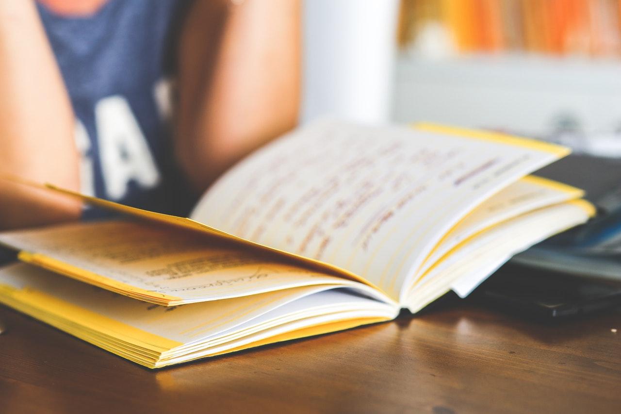 girl reading open notebook