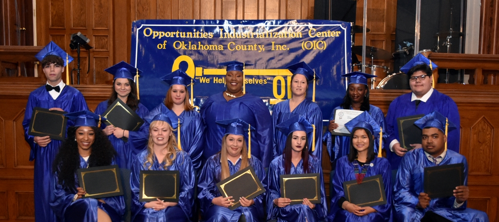 2018 graduates in blue cap and gown
