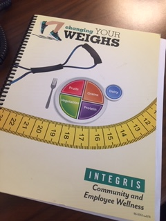 light yellow book cover showing myplate.gov logo and a yellow measuring tape.