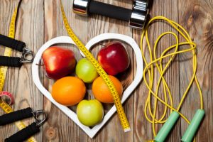 healthy heart of apples, measuring tape, and dumbells